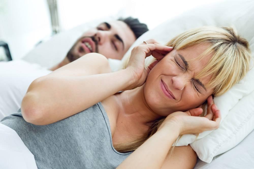 Snoring man disturbing women..